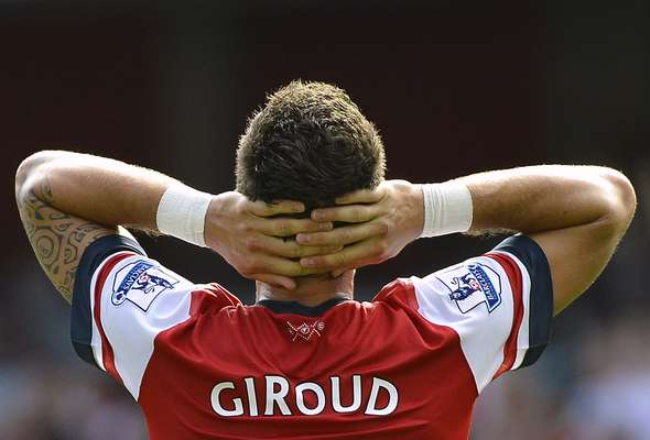 Arsenal's Olivier Giroud reacts following a missed goal-scoring opportunity during their English Premier League soccer match.