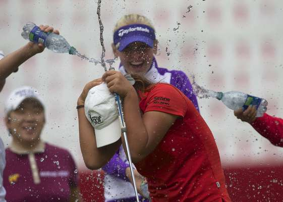 Lydia Ko of New Zealand is doused with water by fellow players after winning the LPGA Canadian Women's Open golf tournament in Coquitlam, British Columbia August 26, 2012. New Zealand teenager Lydia Ko became the youngest player to win a LPGA Tour event when the 15-year-old captured the Canadian Women's Open by three strokes on Sunday.