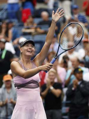 Maria Sharapova of Russia celebrates after defeating Marion Bartoli of France in their women's singles quarterfinals match at the U.S. Open tennis tournament in New York September 5, 2012. REUTERS/Kevin Lamarque