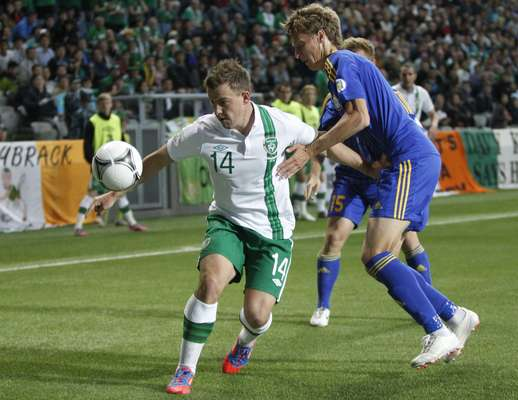Kazakhstan's Alexandr Kirov (R) struggles for the ball with Ireland's Simon Cox during their World Cup 2014 qualifying soccer match in Astana September 7, 2012. REUTERS/Shamil Zhumatov