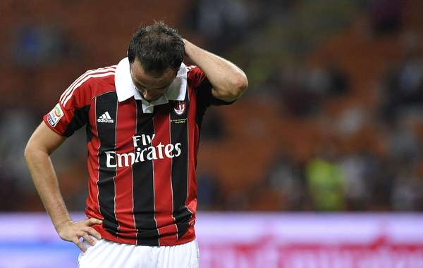 AC Milan's Giampaolo Pazzini is in shock after another home loss, this time to Atalanta. REUTERS/Giorgio Perottino