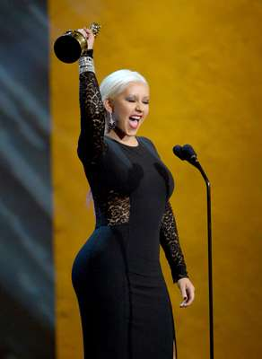 "A voluptuous Christina Aguilera accepted her award the special award for ""The Voice Of A Generation"" during this weekend's ALMA Awards 2012 in California's Pasadena Civic Auditorium. X-Tina's sizzling hot new single, ""Your Body"" is out September 18."