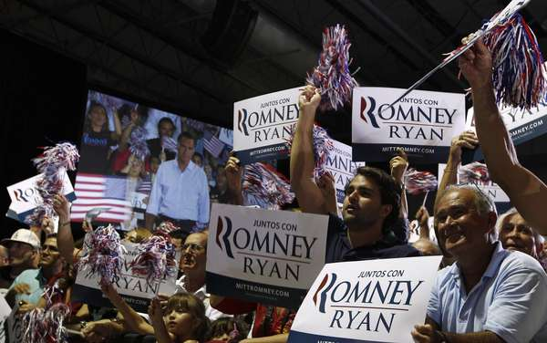 Supporters of U.S. Republican presidential nominee and former Massachusetts Governor Mitt Romney cheer at a campaign rally in Miami, Florida, September 19, 2012. REUTERS/Jim Young (UNITED STATES - Tags: POLITICS ELECTIONS)