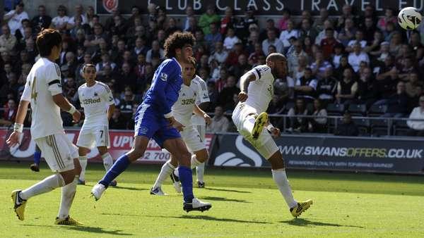 Everton's Marouane Fellaini scores a goal agains tSwansea city.