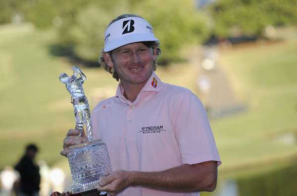 Brandt Snedeker of the U.S. holds the Tour Championship Trophy after winning the Tour Championship golf tournament and the FedExCup at the East Lake Golf Club in Atlanta, Georgia, September 23, 2012. REUTERS/David Tulis (UNITED STATES - Tags: SPORT GOLF)