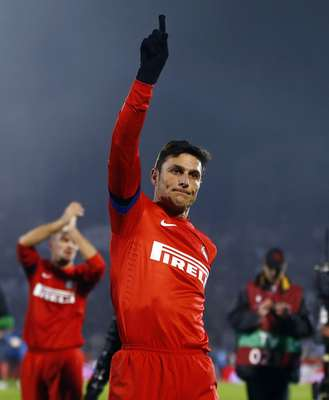 Inter Milan's Javier Zanetti celebrates victory against Partizan Belgrade after their Europa League Group H soccer match in Belgrade November 8, 2012.