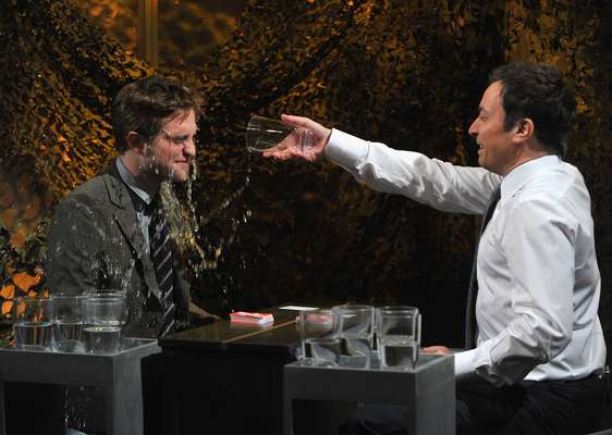 "NOVEMBER 8, 2012: Robert Pattinson got wet and wild with late night host, Jimmy Fallon. The two stars played ""Water War"" during a taping of Jimmy's NBC show in New York City."