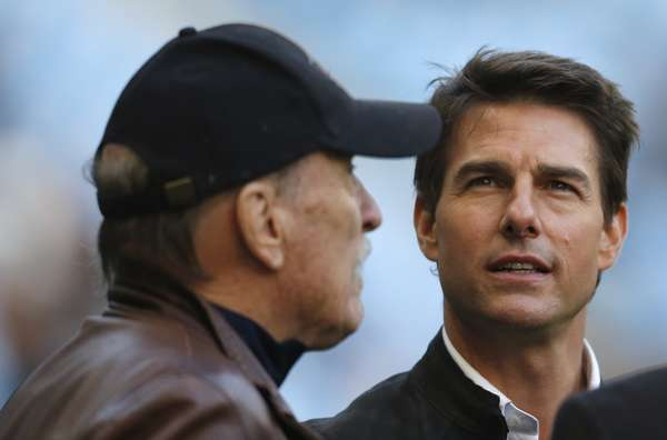 U.S. actors Robert Duvall (L) and Tom Cruise stand by the side of the pitch before the match.