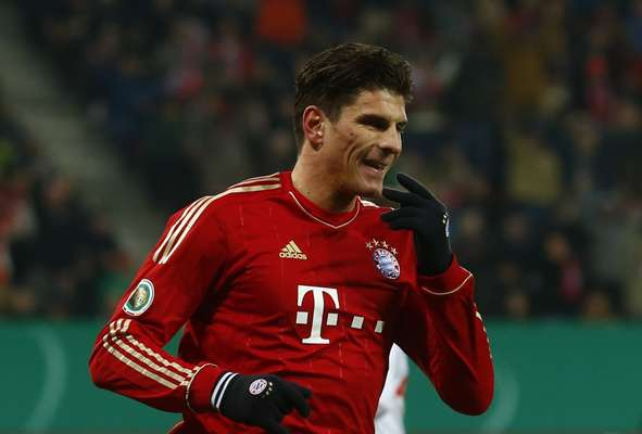 Bayern Munich's Mario Gomez celebrates after he scored against Augsburg during their German DFB Cup (DFB Pokal) round of sixteen soccer match in Augsburg December 18, 2012.
