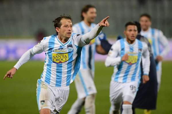 Valencia beat Catania 2-1 to escape relegation.