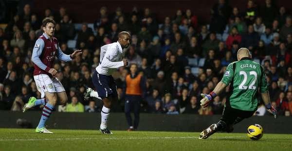 Tottenham Hotspur's Jermain Defoe (C) shoots and scores a goal.