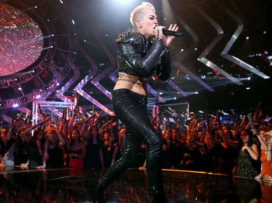 Miley Cyrus said that her gay fans are her favorite audience to perform for. Take a look at the hottest gay icons from today and yesterday.