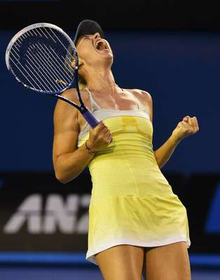 Maria Sharapova of Russia celebrates defeating Venus Williams of the U.S. in their women's singles match at the Australian Open tennis tournament in Melbourne January 18, 2013. REUTERS/Toby Melville