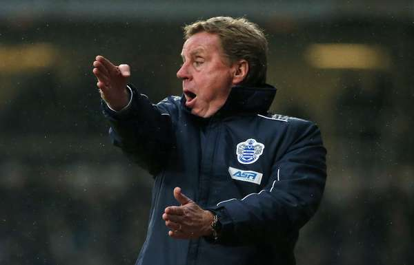 Queens Park Rangers manager Harry Redknapp gestures during their English Premier League soccer match.