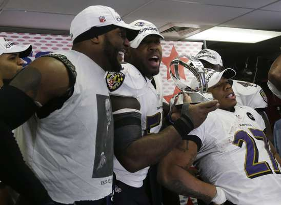 From left, Baltimore Ravens inside linebacker Ray Lewis, Terrell Suggs and Ray Rice celebrate after the NFL football AFC Championship football game against the New England Patriots in Foxborough, Mass., Sunday, Jan. 20, 2013. The Ravens defeated the Patriots, 28-13, to advance to Super Bowl XLVII.