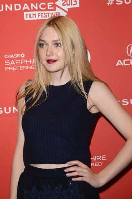 Dakota Fanning wore a Louis Vuitton crop top and a mini skirt at the Sundance Film Festival. The actress was bold in wearing something so revealing as it is extremely chilly in Utah. What do you think of this look?