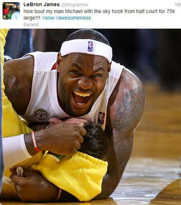 Every once in a while sport produces a moment of pure joy. On Friday night, it happened a Miami Heat basketball game when a fan sank a half-court shot to win $75,000. As wonderful as the moment was, it was that much better because LeBron James forgot for a moment that he was the world's best basketball player in the middle of a game and ran over and tackled the fan to share in his big moment. Kudos to you, LeBron.