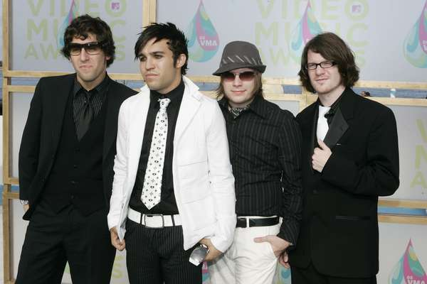 "Fall Out Boy are back after a three-year hiatus with the announcement of the new album, 'Save Rock and Roll' and a new song, ""My Songs Know What You Did In the Dark (Light Em Up)."" To celebrate their return, we complied some pictures of the band throughout their pop career. Take a look at FOB from TV appearances to sharing the stage with Rihanna ahead."