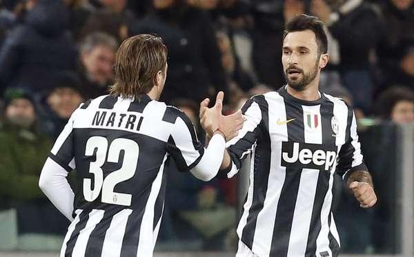 Juventus' Mirko Vucinic (R) celebrates with Alessandro Matri after scoring.