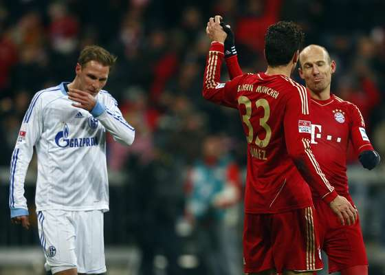 Bayern Munich's Mario Gomez (33) celebrates with teammate Arjen Robben.