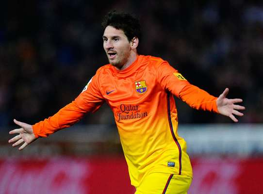 Messi celebrates after his 300th goal for Barcelona.