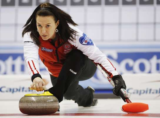 Team Canada skip Heather Nedohin throws a rock against British Columbia during the ninth draw at Scotties Tournament of Hearts curling championship in Kingston, February 19, 2013. REUTERS/Mark Blinch (CANADA - Tags: SPORT CURLING)