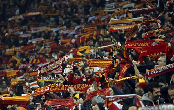 Galatasaray's supporters cheer their team before their match against Schalke 04 during their Champions League soccer match at Turk Telekom Arena in Istanbul February 20, 2013. REUTERS/Murad Sezer