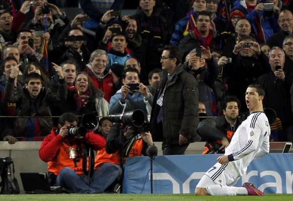 Real Madrid's Cristiano Ronaldo celebrates after scoring a penalty against Barcelona during their Spanish King's Cup semifinal second round soccer match at Camp Nou.