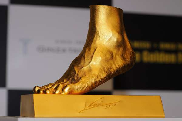Golden statue of the left foot of Lionel Messi is displayed at the launching at Harajuku Quest Hall on March 6, 2013 in Tokyo, Japan.