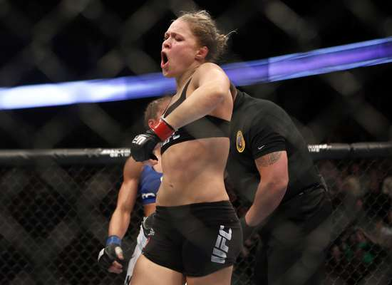 Ronda Rousey defended her UFC title against Liz Carmouche on February 23 as the headlining fight on a PPV card, winning by arm bar submission in the first round, in the first women's event in UFC history.