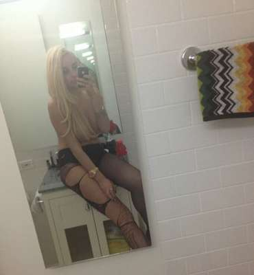 "Topless! Amanda Bynes posted this picture with the caption ""Long hair, don't care"" to her followers."