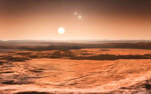 """Astrônomos descobriram um sistema com até sete planetas em torno da estrela de baixa massa Gliese 667 C - a uma distância de apenas 1/20 da existente entre a Terra e o Sol. Três desses planetas são """"super-Terras"""" orbitando em torno da estrela em uma região onde a água pode existir sob forma líquida, o que torna estes planetas bons candidatos à presença de vida. Este é o primeiro sistema descoberto onde a zona habitável se encontra repleta de planetas. Leia mais -"""