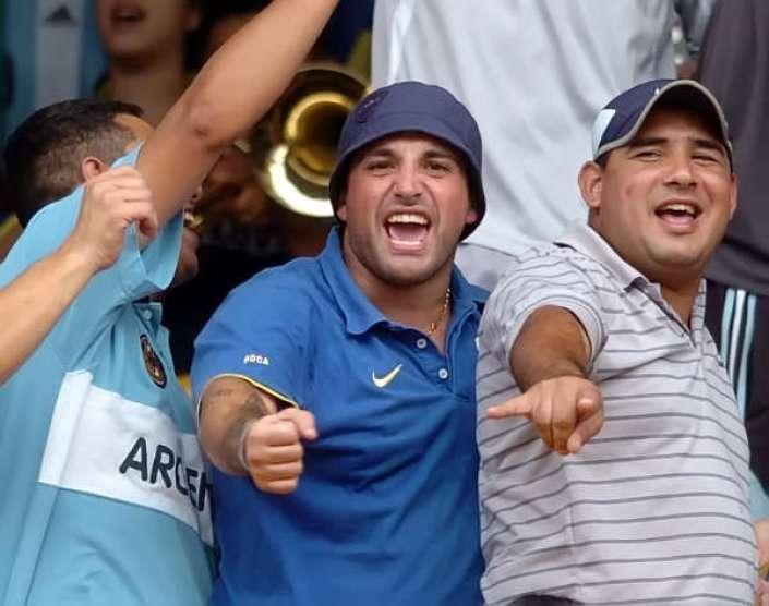 Mauro Martín (de azul) y su ladero Maxi Mazzaro (de rayado) en la tribuna Foto: Archivo