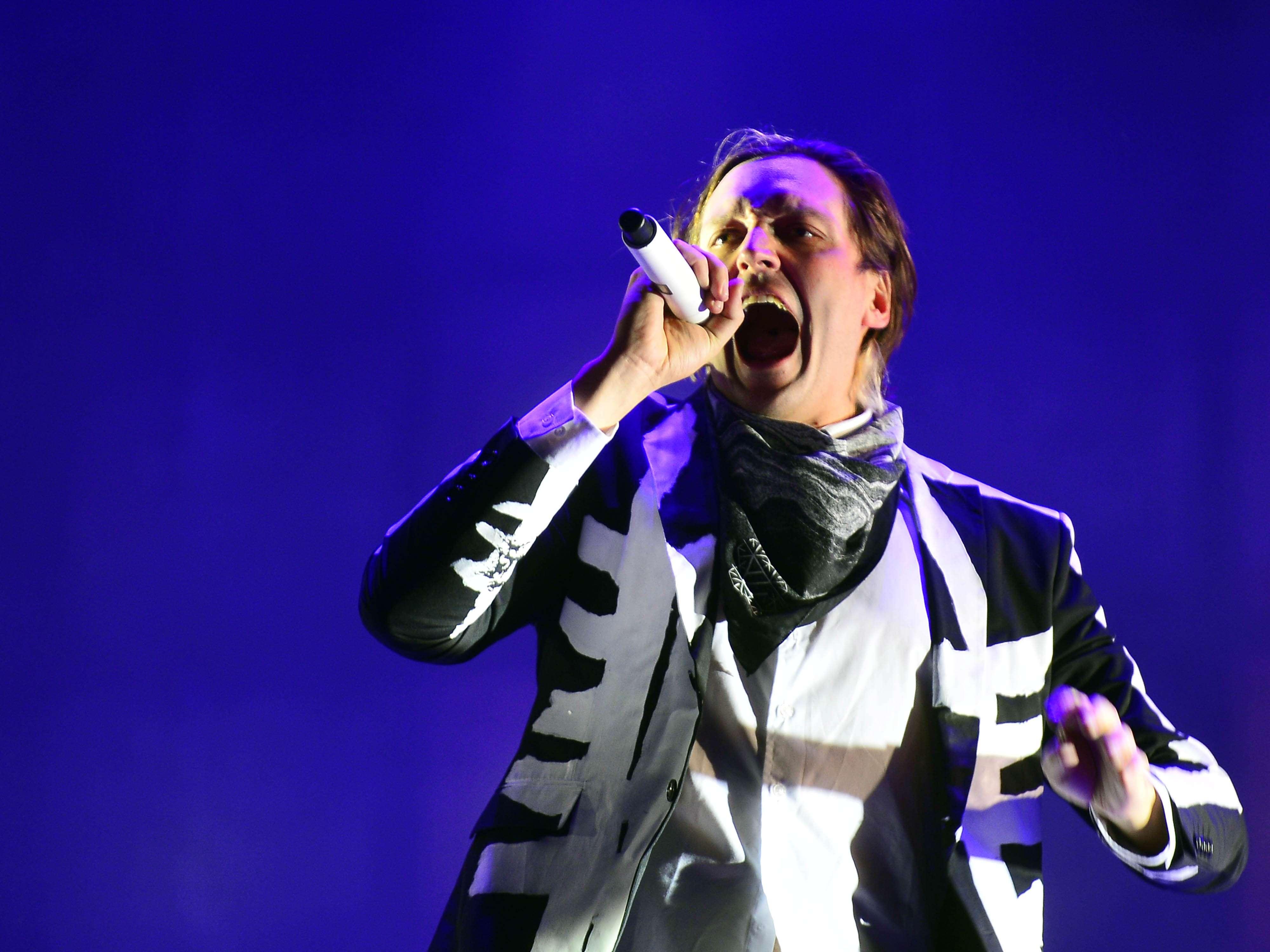 Uma das grandes atrações da noite, a banda canadense Arcade Fire se apresentou no domingo (06) no Lollapalooza 2014 Foto: Alan Morici/Terra