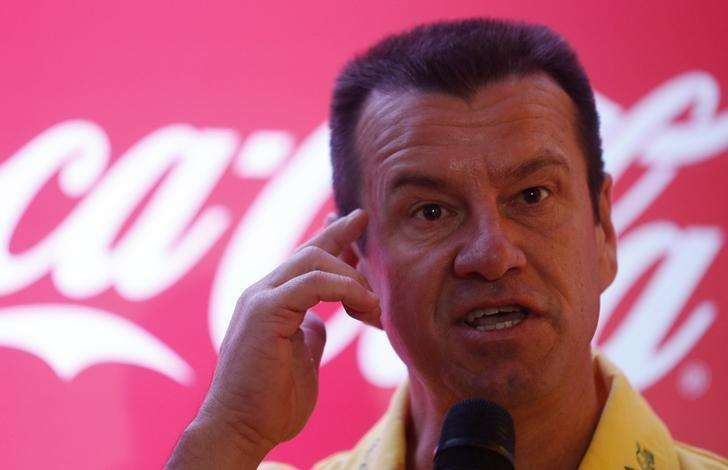 Dunga is favorite to coach Brazil's soccer team - sources