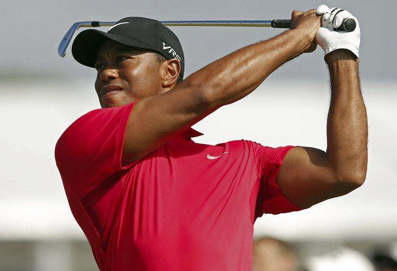 PGA Tour commissioner and Woods hope for big 2014 finish