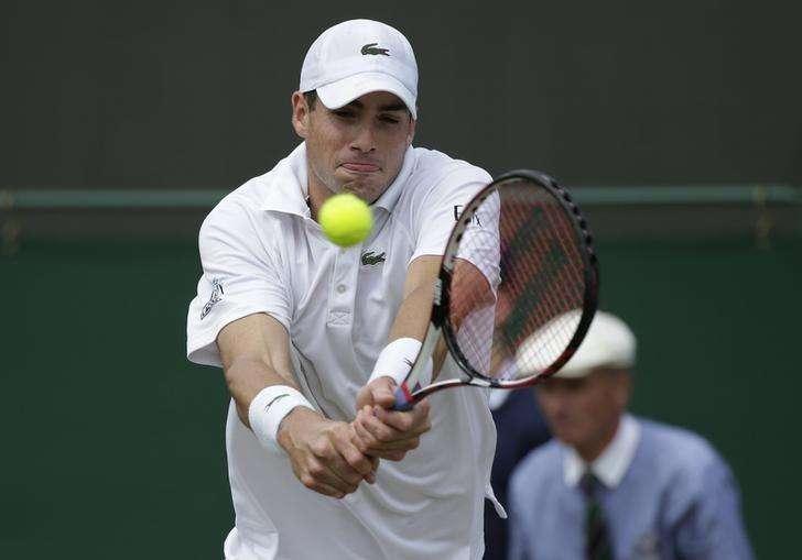 Tennis-No backhanded compliments for Federer from Edberg