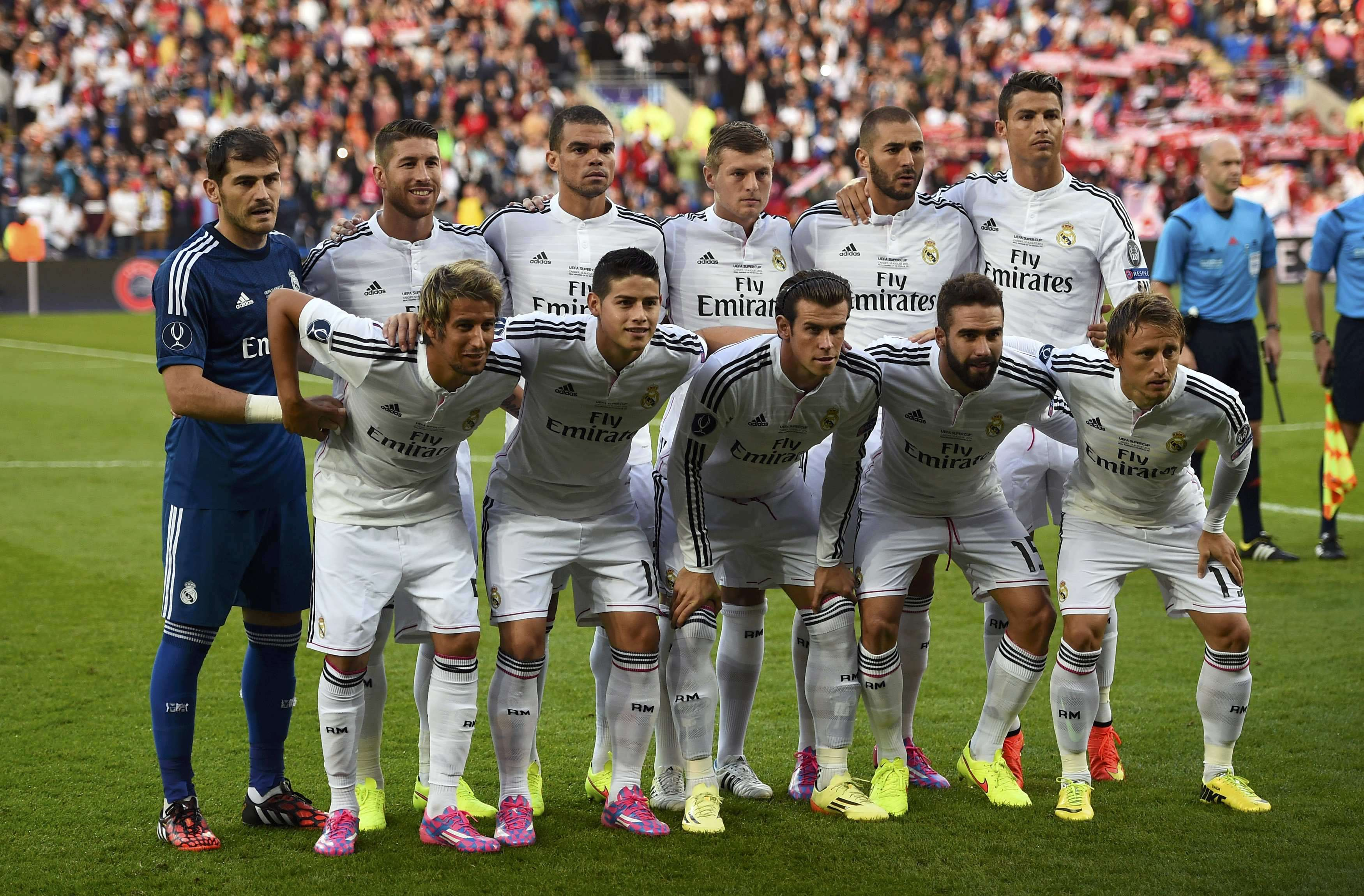 Real Madrid's players pose for team picture before the UEFA Super Cup final soccer match against Sevilla at Cardiff City stadium, Wales, August 12, 2014. REUTERS/Rebecca Naden (BRITAIN - Tags: SPORT SOCCER) Foto: DYLAN MARTINEZ/REUTERS