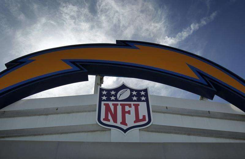 NFL, under public pressure, toughens domestic violence bans