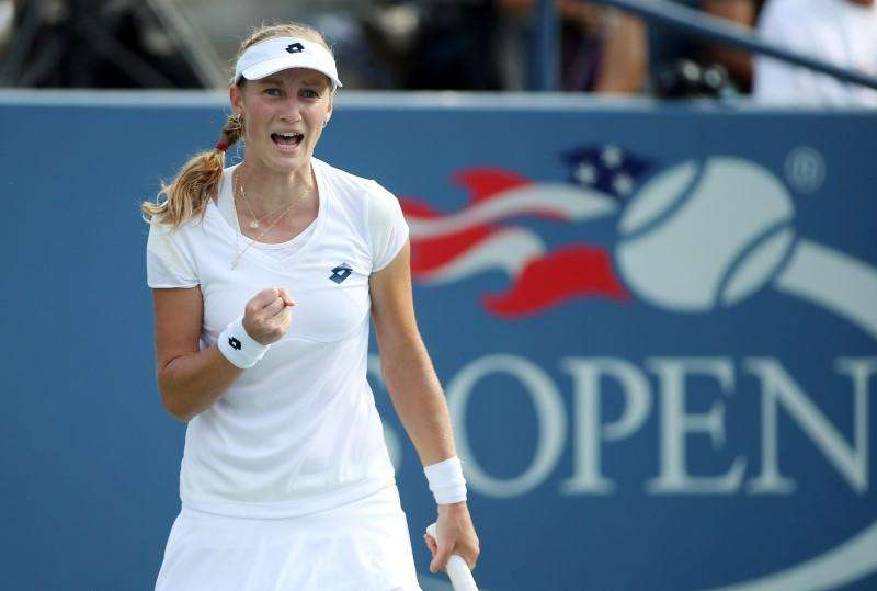 Makarova moves on as Bouchard wilts under punishing heat