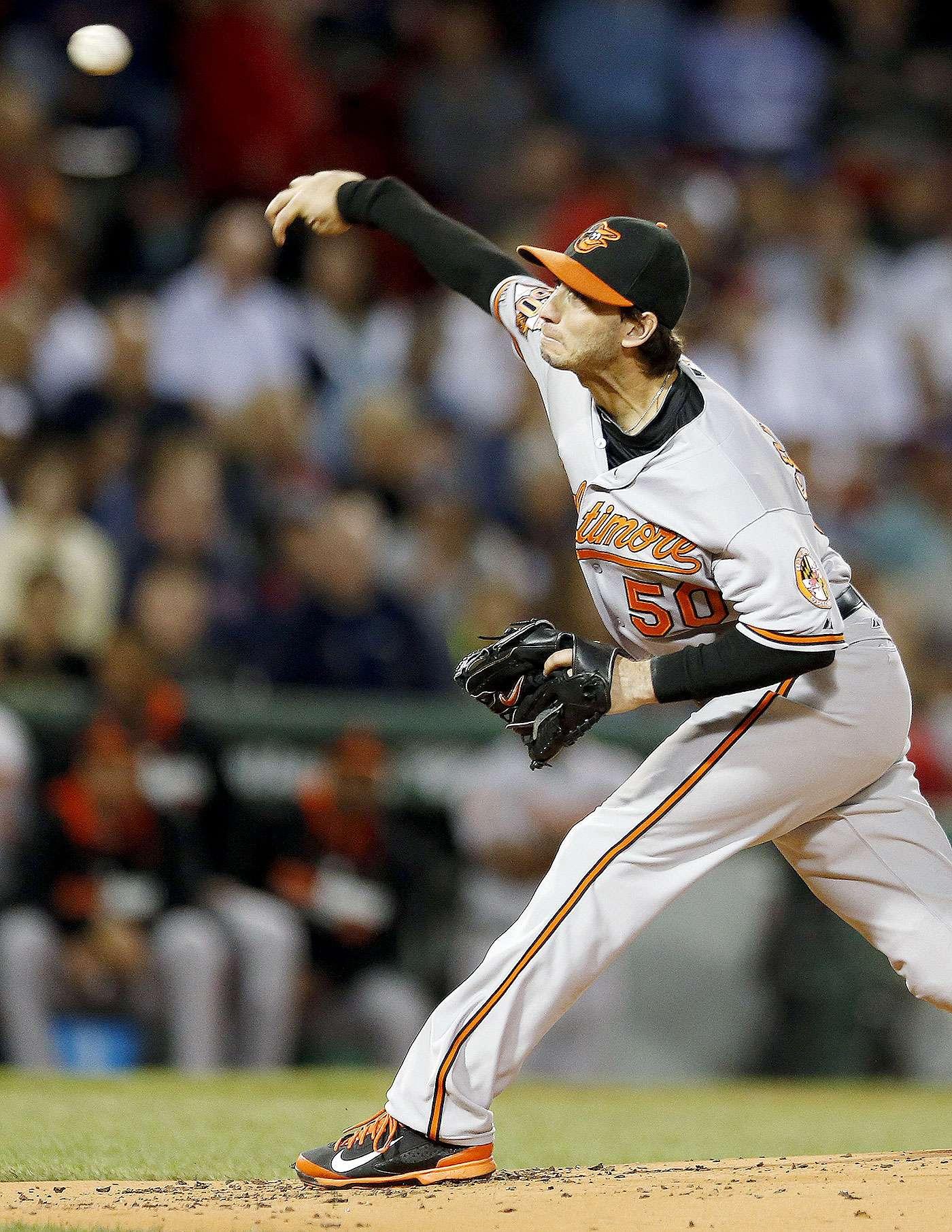 Miguel González de los Orioles de Baltimore lanza en el primer inning ante los Medias Rojas de Boston, el lunes 8 de septiembre de 2014. Foto: Michael Dwyer/AP