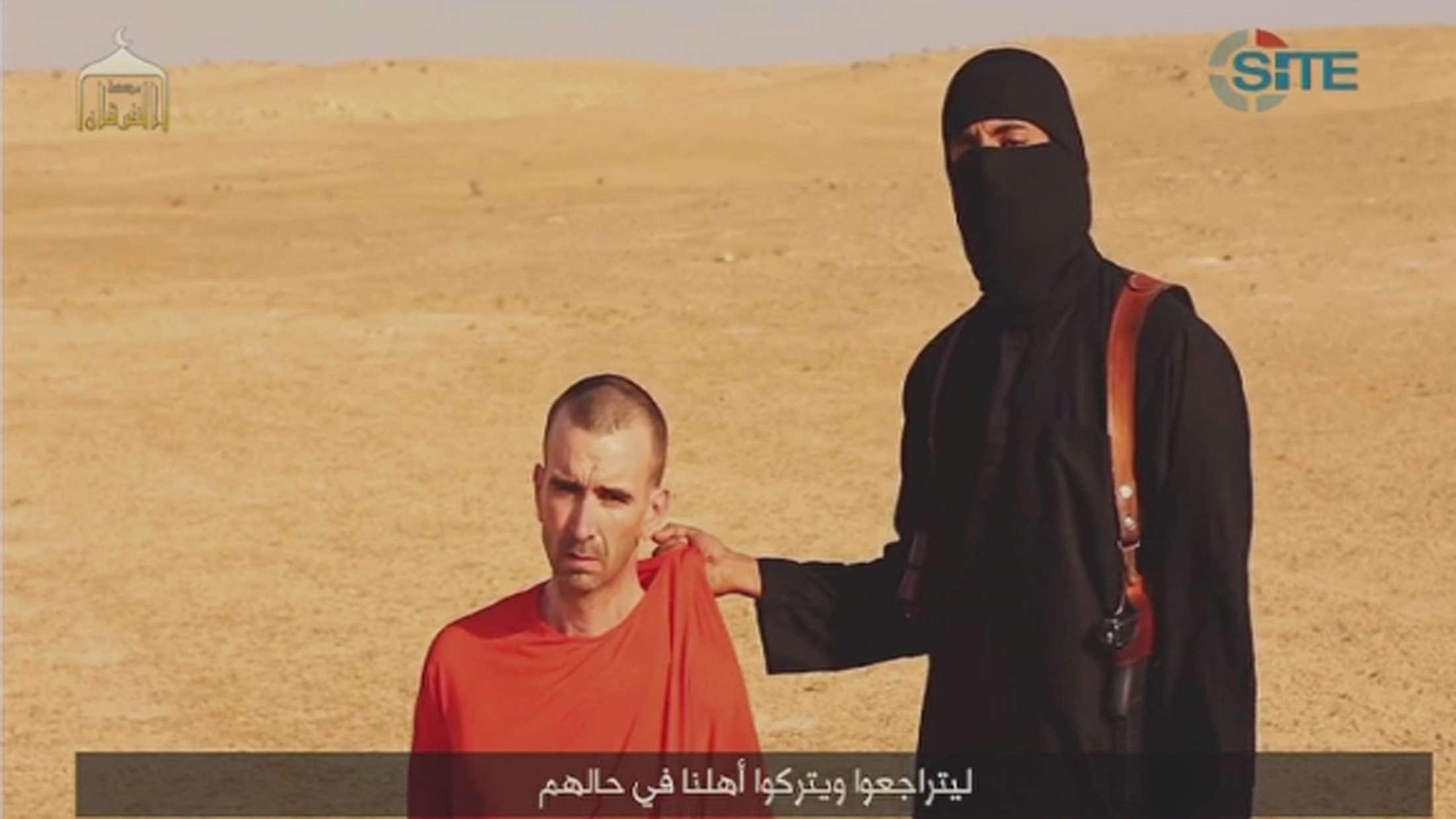 Imagem de vídeo que supostamente mostra a decapitação do voluntário britânico David Haines Foto: Reuters