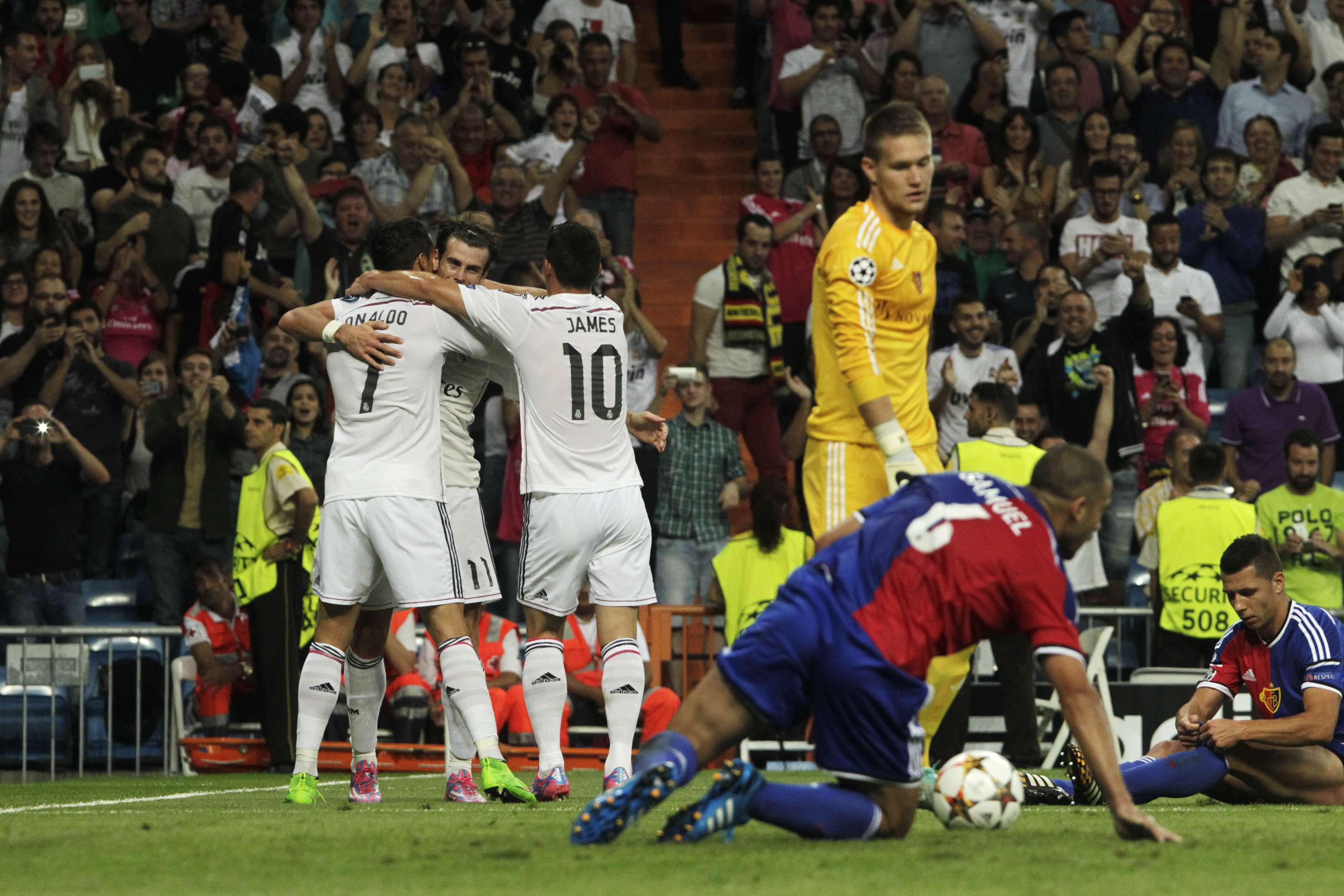 Jogadores do Real Madrid festejam goleada sobre o Basel; confira imagens da rodada da Liga dos Campeões Foto: Gabriel Pecot/AP