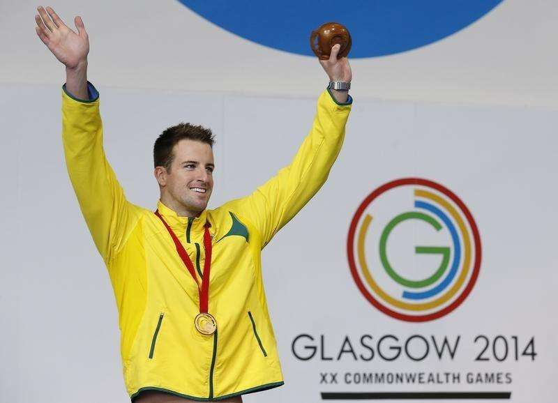 Australia's James Magnussen celebrates after winning the gold medal in men's 100m Freestyle final at the 2014 Commonwealth Games in Glasgow, Scotland, July 27, 2014. Foto: Jim Young/Reuters