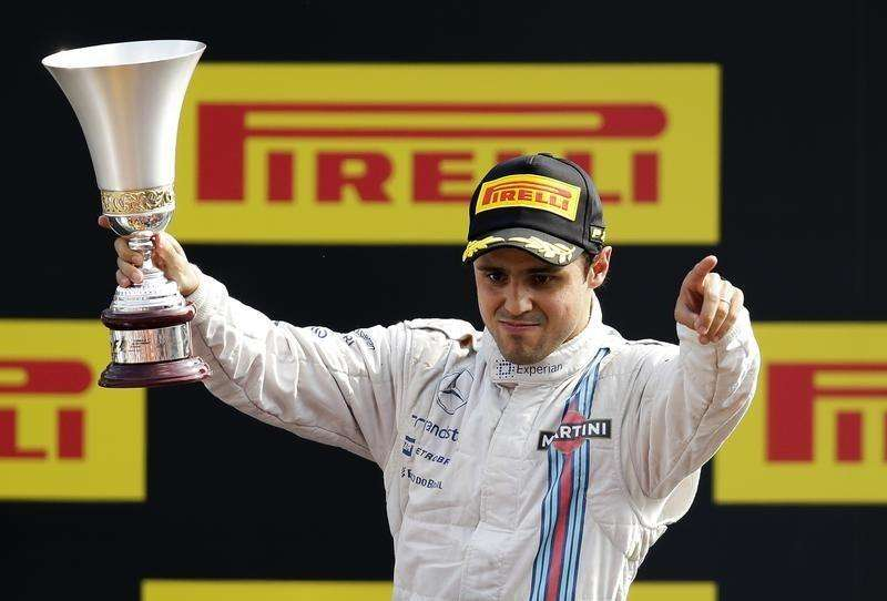 Williams Formula One driver Felipe Massa of Brazil celebrates on the podium with his Italian F1 Grand Prix third-placed winner trophy in Monza September 7, 2014. Foto: Max Rossi/Reuters