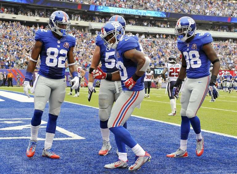 Victor Cruz volvió a bailar salsa en el triunfo de Giants sobre Texans. Foto: AFP