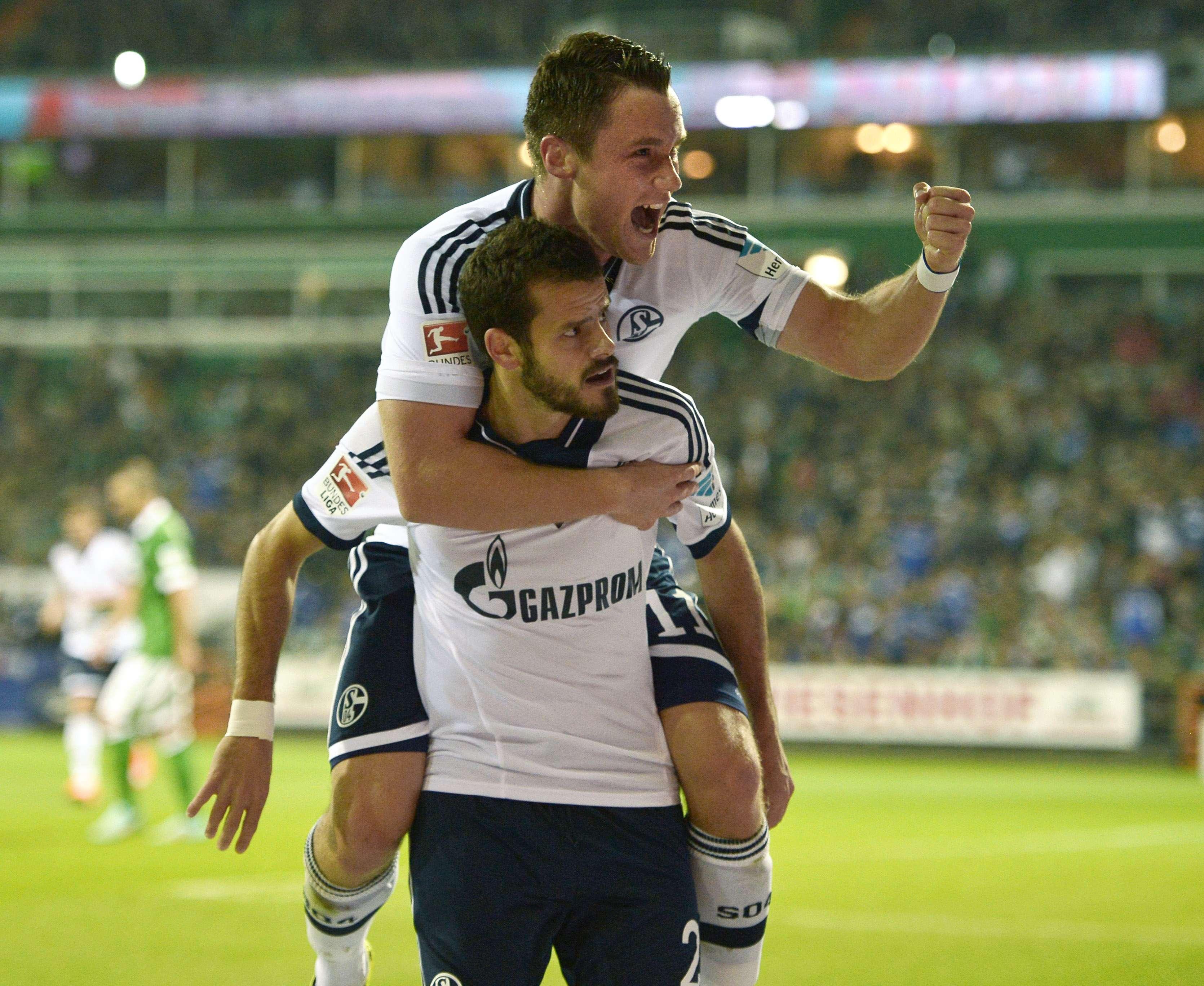 Clemens y Barnetta celebran un gol ante el Bremen. Foto: AP en español