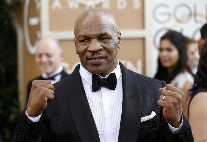 Boxer Mike Tyson arrives at the 71st annual Golden Globe Awards in Beverly Hills, California January 12, 2014. Foto: Mario Anzuoni/Reuters