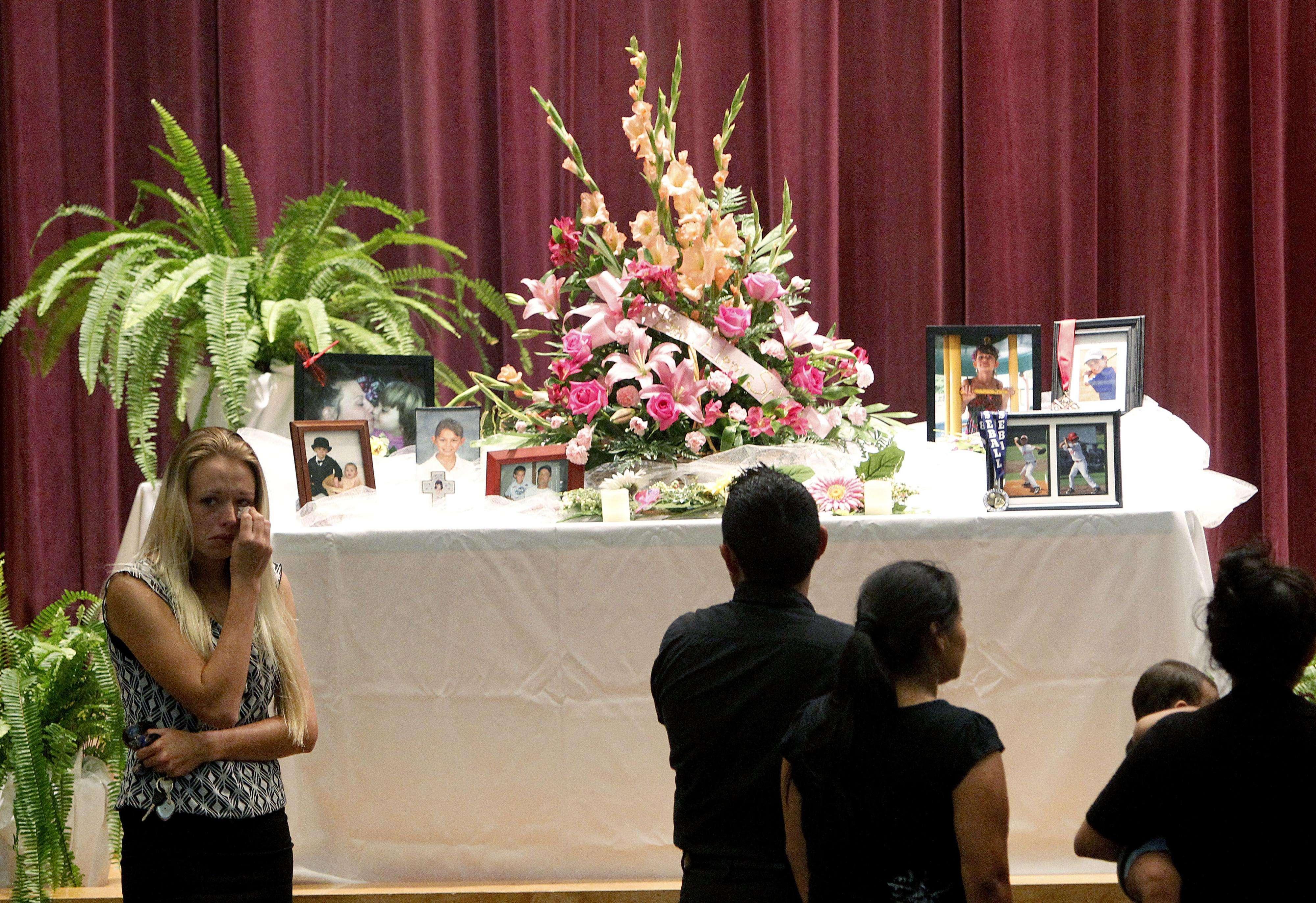 Servicio funerario en memoria de las pequeñas víctimas realizado el 21 de septiembre en Bell, Fla. Foto: AP en español