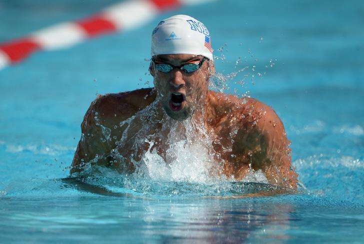 Michael Phelps swims 1:58.74 in a 200m individual medley heat to advance to the final in the 2014 USA National Championships at William Woollett Jr. Aquatics Complex.Aug 10, 2014; Irvine, CA, USA; Kirby Lee-USA TODAY Sports. Foto: Reuters